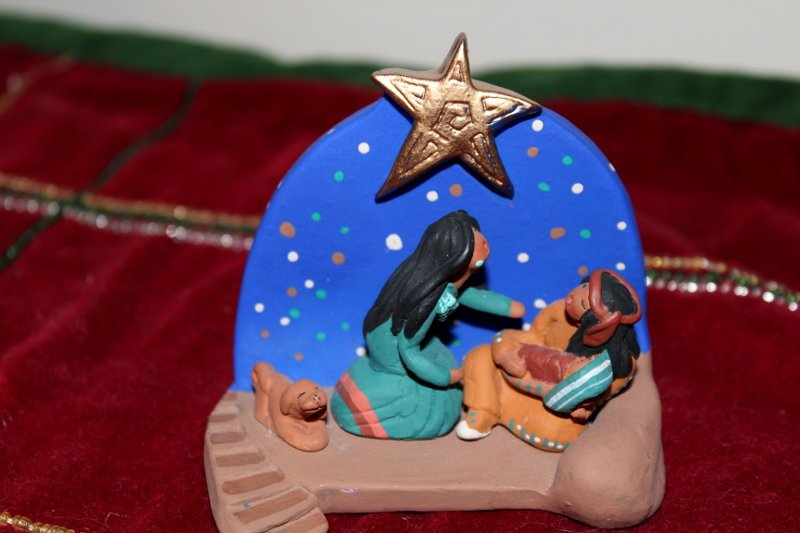 Nativity from Apache Indian tribe. The father holds the Christ Child in their Nativity scenes.
